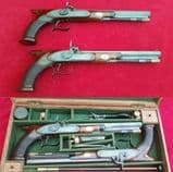 * * * A cased pair of saw-handled Percussion Duelling pistols by COLE superb condition. Ref 1674.