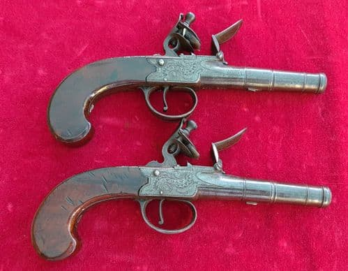 A fine pair of English Queen Anne  cannon barrelled flintlock pistols by Willmore London. Ref  3348