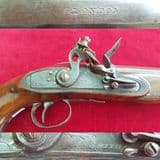 A large .65 cal Flintlock Pistol made by Smith of London. Circa 1790. Ref 1581.