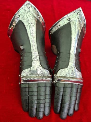 A pair of German black and white steel gauntlets in 17th C. style. Probably 19th century Ref 3296