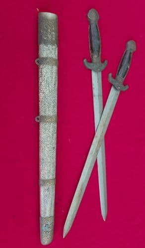 A rare CHINESE double short sword with two blades, in original brass mounted scabbard. Ref 3142