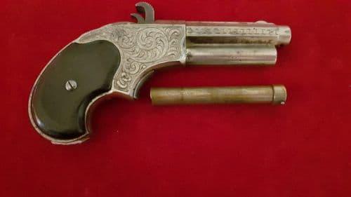 A rare factory engraved Remington Rider .32 rim-fire magazine pistol C.1871. Good condition.Ref 2613