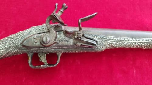 A rare Greek or Balkan flintlock pistol with superb embossed silver decoration. Circa 1830. Ref 2920