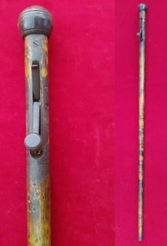 A rareunder hammer approx.60 calibre percussion Walking stick gun. Circa 1830. Well used.Ref 1416.