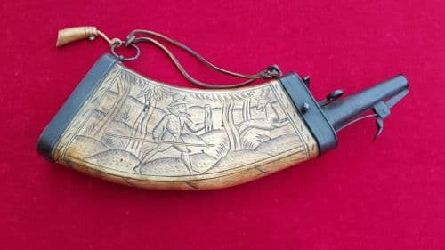 A rare wheel-Lock period powder horn engraved with a hunting scene of figure and Deer. Ref 8528.
