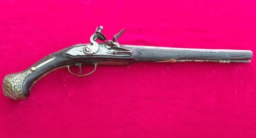 A Scarce Balkan or Turkish Flintlockpistol with embossed brass mounts.. Circa 1830. Ref 2879