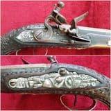 A silver inlaid Balkan Flintlock pistol Circa 1800. Heavy silver decoration. Ref 9853.