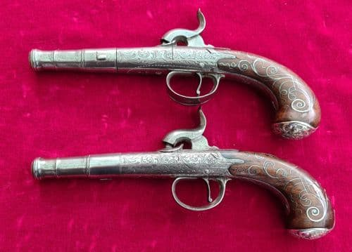 A Superb pair of silver mounted Queen Anne pistols converted from flintlock. Circa 1800. Ref 3228