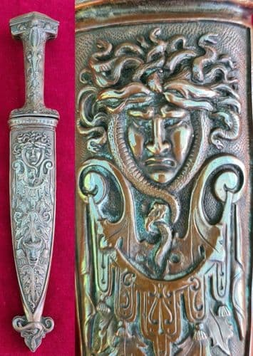 A superb Romantic dagger, embossed with devils heads, dating from the mid 19th century. Ref 3578