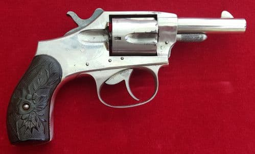 X  X  X  SOLD X  X  X  American Eagle double action nickel plated .32 rimfire revolver. Ref 1537