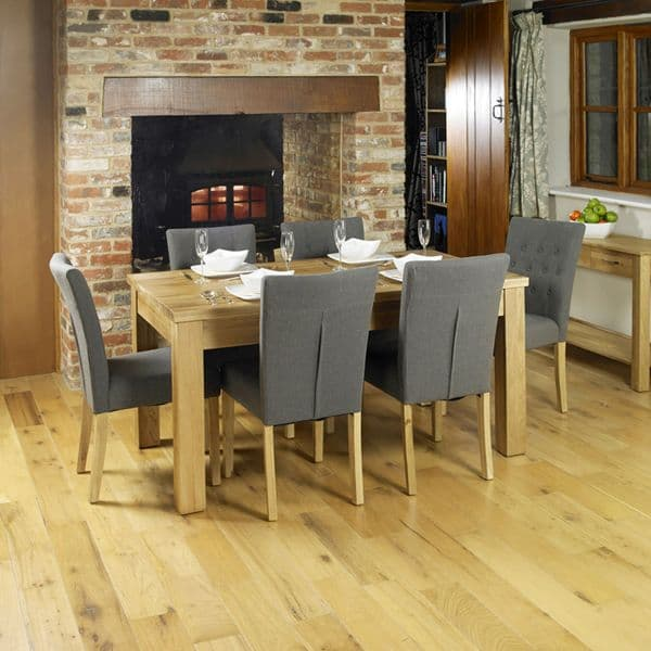 Mobel dining set includes a solid medium oak dining table and a choice of six or four chairs.