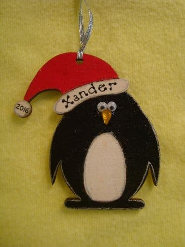 """Personalised Wooden Penguin in Santa Hat Shaped Christmas Tree Hanger Decoration  Hand Painted Stocking Filler"